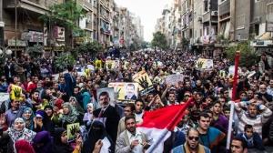 Tổ chức Anh em Hồi giáo ủng hộ Tổng thống bị phế truất Mohamed Morsi tại Al-Matareya, ngoại ô Cairo (Ảnh: Tân Hoa xã)