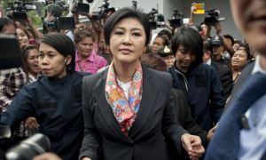 Yingluck Shinawatra meets her supporters on 7 May in Bangkok after being forced to step down