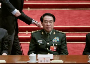 Vice Chairman of China's Central Military Commission Xu Caihou attends the closing ceremony of the China's parliament in Beijing