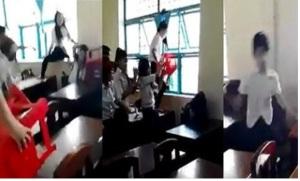 Học sinh lớp 7 đánh hội đồng bạn (ảnh cắt từ clip)