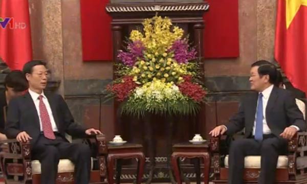 Chủ tịch nước Trương Tấn Sang (phải) tiếp ông Trương Cao Lệ