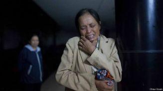Bà Đỗ Thị Mai mẹ bị can vị thành niên Đỗ Đăng Dư chụp sau khi con trai của bà qua đời. (Ảnh: Châu Đoàn)