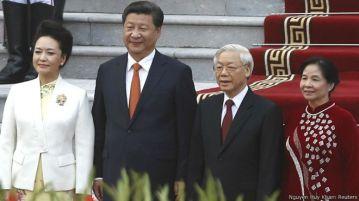 Ông Tập Cận Bình thăm Việt Nam sau các diễn biến giàn khoan 981 và các xung đột với ngư dân trên Biển Đông. Photo: Nguyen Huy Kham/ Reuters