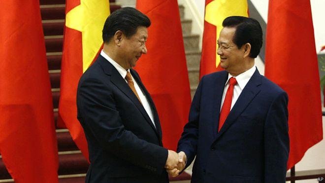 Chủ tịch Tập Cận Bình mời Thủ tướng Nguyễn Tấn Dũng thăm Trung Quốc vào thời điểm thích hợp. Photo: AP