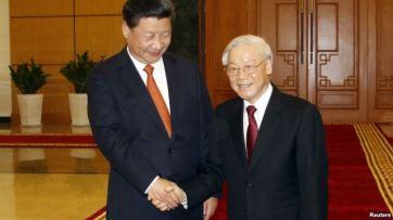 Chủ tịch Trung Quốc Tập Cận Bình và Tổng bí thư Nguyễn Phú Trọng trong một cuộc gặp ở Hà Nội hôm 5/11/2015. Photo: Reuters