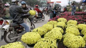 Chợ hoa Hà Nội. Ảnh: AP
