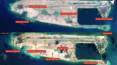 """Một hòn đảo mà Trung Quốc đang xây dựng trên Đá Chữ Thập ở Biển Đông. Chính quyền Trung Quốc đang cáo buộc """"quyền bá chủ"""" của Mỹ đã thách thức cho vùng đất mà họ chiếm đoạt ở Biển Đông (South China Sea). (ảnh: IHS Jane's)"""
