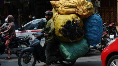 Lãnh đạo Việt Nam kỳ vọng nâng mức thu nhập trung bình lên trên 7.000 USD vào năm 2035 nếu đạt tỷ lệ tăng trưởng GDP tối thiểu 7% mỗi năm từ nay. Photo: Gety