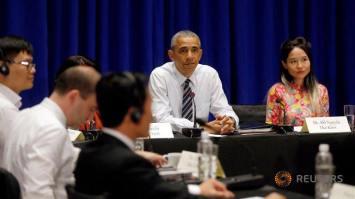 Ca sĩ Mai Khôi trong buổi gặp gỡ TT Obama. Nguồn: Reuters