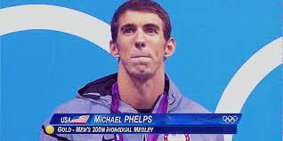 Michael Phelps đang mím chặt môi để khỏi bật ra tiếng khóc. Ảnh: internet