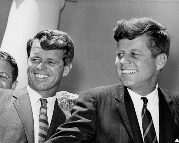 Washington, D.C.: A close up study of John F. Kennedy and his brother, Robert Kennedy, reveals their cordial smile as they stood shoulder to shoulder at a recent presentation held at the White House.