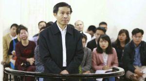 Blogger Ba Sàm Nguyễn Hữu Vinh và cộng sự bị xét xử theo điều 258 Bộ luật Hình sự của nhà nước Việt Nam. Ảnh: AP