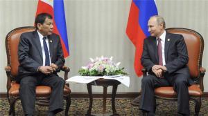 Rodrigo Duterte, left, listens to President Vladimir Putin during their meeting [Mikhail Klimentyev, Sputnik via AP