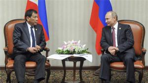 Rodrigo Duterte, left, listens to President Vladimir Putin during their meeting [Mikhail Klimentyev, Sputnik via AP