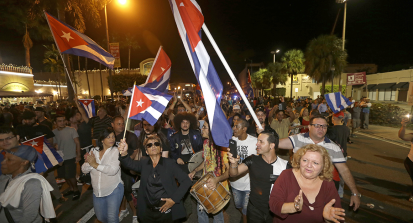 Cuban-Americans celebrate the death of Fidel Castro, Saturday, Nov. 26, 2016, in the Little Havana area in Miami. | AP Photo/Alan Diaz