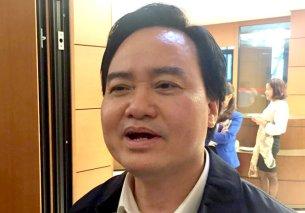 Bộ trưởng Bộ GD-ĐT Phùng Xuân Nhạ trao đổi với báo chí sáng 14-11 - Ảnh: Đ.BÌNH/ VNN