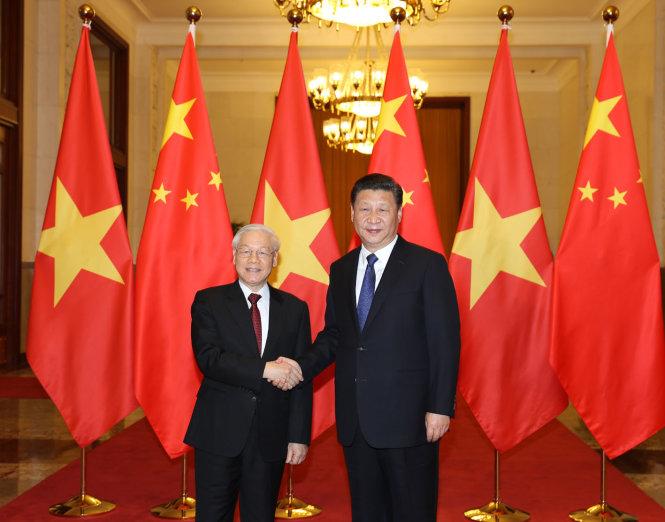 Tổng bí thư Nguyễn Phú Trọng bắt tay với Tổng bí thư, Chủ tịch Trung Quốc Tập Cận Bình tại Bắc Kinh chiều 12-1 -Ảnh: TTXVN