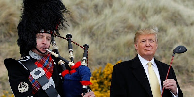 U.S. property mogul Donald Trump (R) stands next to a bagpiper during a media event on the sand dunes of the Menie estate, the site for Trump's proposed golf resort, near Aberdeen, north east Scotland May 27, 2010. REUTERS/David Moir (BRITAIN POLITICS - Tags: SPORT GOLF BUSINESS)