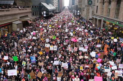 Demonstrators clinging to placards fill the streets of Midtown, Manhattan in New York as they